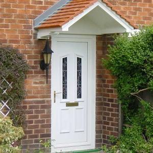 Clean, white uPVC front door
