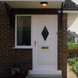 White uPVC front door with diamond glazing