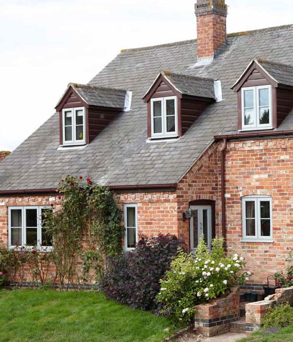 Brick house full of replacement uPVC windows