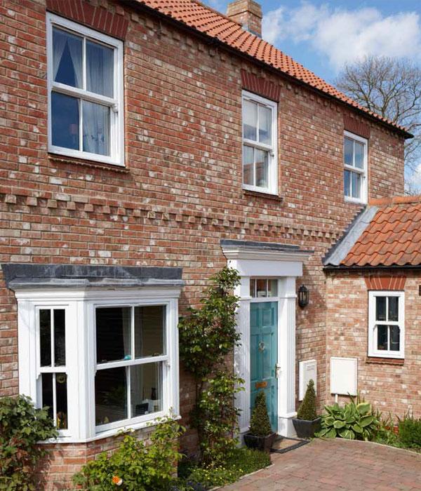 Replacement uPVC sash windows in brick cottage